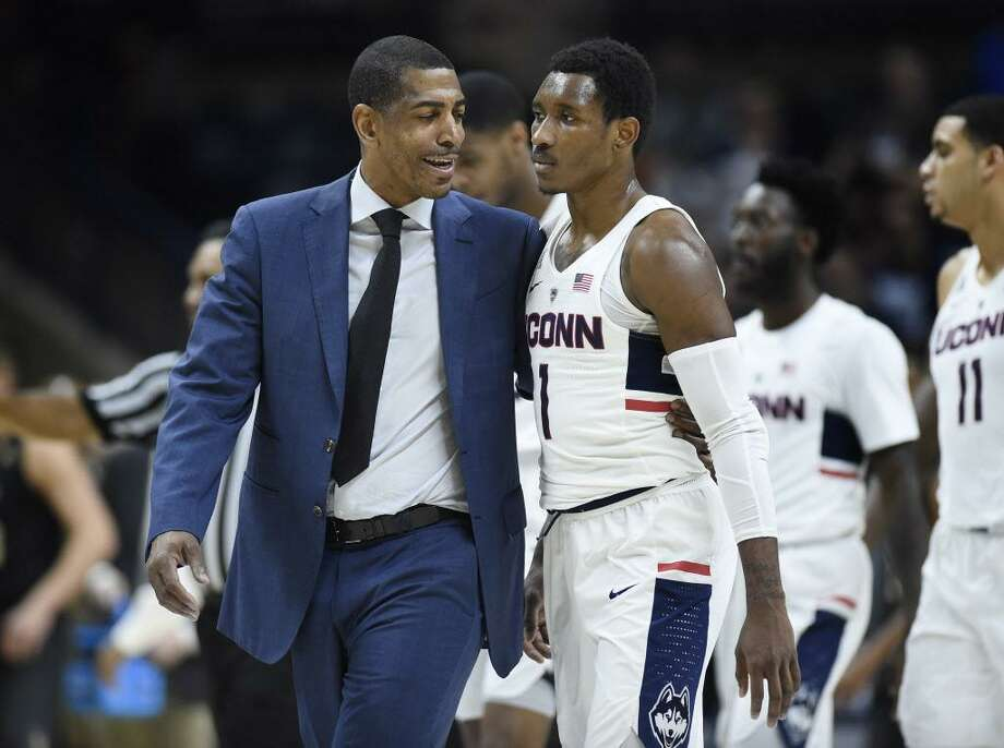 UConn coach Kevin Ollie talks with guard Christian Vital after the first half of Wednesday's 62-53 victory. Photo: Jessica Hill / Associated Press / AP2018