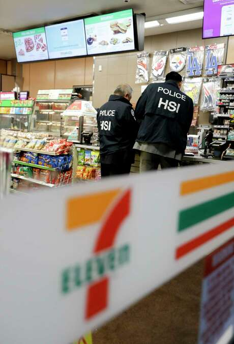 ICE agents serve an employment audit notice at a Los Angeles 7-Eleven convenience store, one of nearly 100 stores to be targeted.   Photo: Chris Carlson, STF / Copyright 2018 The Associated Press. All rights reserved.