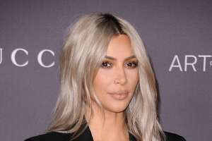 """17) Kim Kardashian to Kanye West and North West     Kardashian went all out for North's first Christmas, purchasing her a miniature black Lamborghini. Did we mention Kanye got one too? But his was real, of course. Her  Instagram caption read , """"Like father, like daughter."""""""