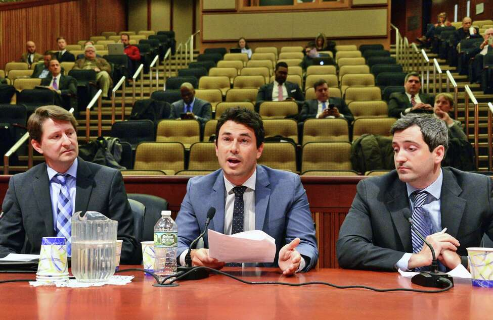 Testifying before the Assembly Standing Committee on Racing and Wagering, from left, Chairman of Fantasy Sports Trade Assoc., Peter Schoenke, FanDuel VP Ari Borod and counsel for DraftKings Griffin Finan discuss Interactive Fantasy Sports in New York State Wednesday Jan. 10, 2018 in Albany, NY. (John Carl D'Annibale/Times Union)