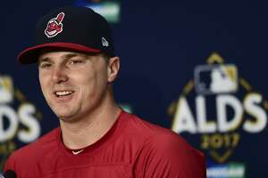 Cleveland Indians' Jay Bruce answers questions after Game 1 of baseball's American League Division Series between the New York Yankees and the Cleveland Indians, Thursday, Oct. 5, 2017, in Cleveland. The Indians won 4-0. (AP Photo/David Dermer)
