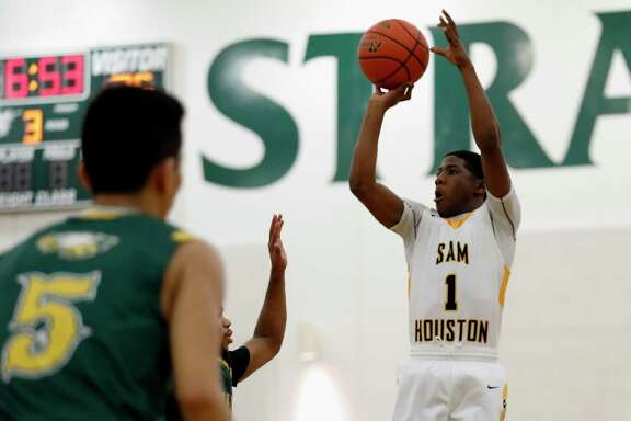 Sam Houston guard Kendric Davis, right, is one of four area boys nominees for the McDonald's All-American team.