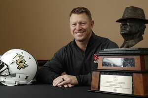 """University of Nebraska head coach Scott Frost, formerly with the University of Central Florida, with the Paul """"Bear"""" Bryant award at the Hilton Americas ahead of the 32nd Annual American Heart Association's Paul """"Bear"""" Bryant Awards presented by Marathon Oil Corporation, Wednesday, Jan. 10, 2018, in Houston.   ( Karen Warren / Houston Chronicle )"""