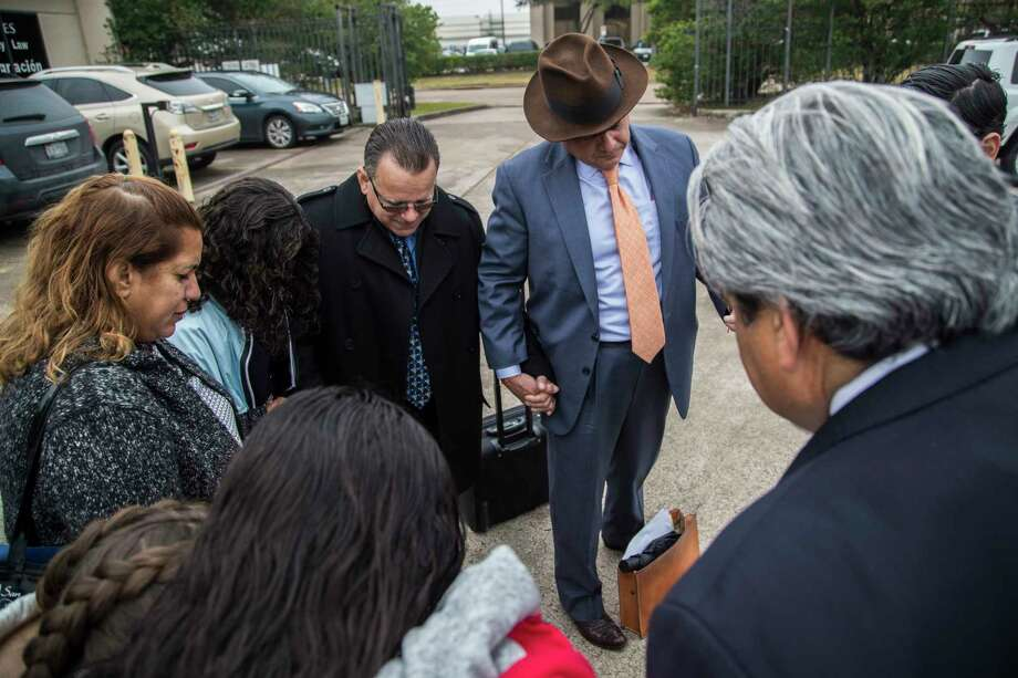 Juan Rodriguez holds hands in prayer with his family and attorneys including Jacob Monty, center, after presenting himself to the Immigration and Customs Enforcement agency, Wednesday, Jan. 10, 2018, in Houston. Rodriguez was granted another 30 days to continue working on his case.  ( Marie D. De Jesus / Houston Chronicle ) Photo: Marie D. De Jesus, Houston Chronicle / © 2018 Houston Chronicle