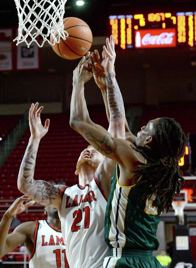 Lamar's Colton Weisbrod battles with Southeastern Louisiana's James Currington for the rebound during their match-up Wednesday at the Montagne Center. Photo taken Wednesday, January 10, 2018 Kim Brent/The Enterprise Photo: Kim Brent / BEN