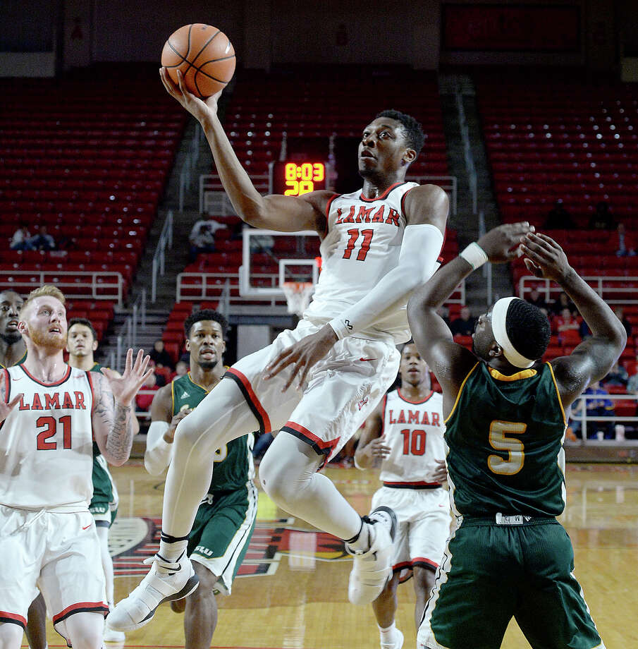 Lamar's Josh Nzeakor soars to the basket as Southeastern Louisiana's Jabbar Singleton defends below the basket during their match-up Wednesday at the Montagne Center. Photo taken Wednesday, January 10, 2018 Kim Brent/The Enterprise Photo: Kim Brent / BEN