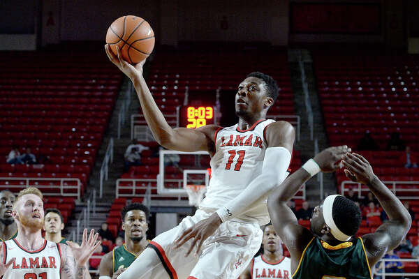 Lamar's Josh Nzeakor soars to the basket as Southeastern Louisiana's Jabbar Singleton defends below the basket during their match-up Wednesday at the Montagne Center. Photo taken Wednesday, January 10, 2018 Kim Brent/The Enterprise