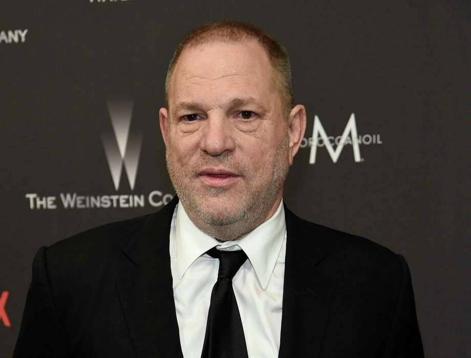 FILE - In this Jan. 8, 2017, file photo, Harvey Weinstein arrives at The Weinstein Company and Netflix Golden Globes afterparty in Beverly Hills, Calif.  A lawyer who represented actress Paz de la Huerta has filed a lawsuit against Weinstein and a former New York prosecutor, alleging they coordinated in a scheme to get the actress to drop her sexual misconduct complaint against the movie mogul. Aaron Filler's firm, Tensor Law, filed the lawsuit Friday, Jan 5, 2018 against Weinstein, his company and attorney Michael Rubin. (Photo by Chris Pizzello/Invision/AP, File) Photo: Chris Pizzello / Invision