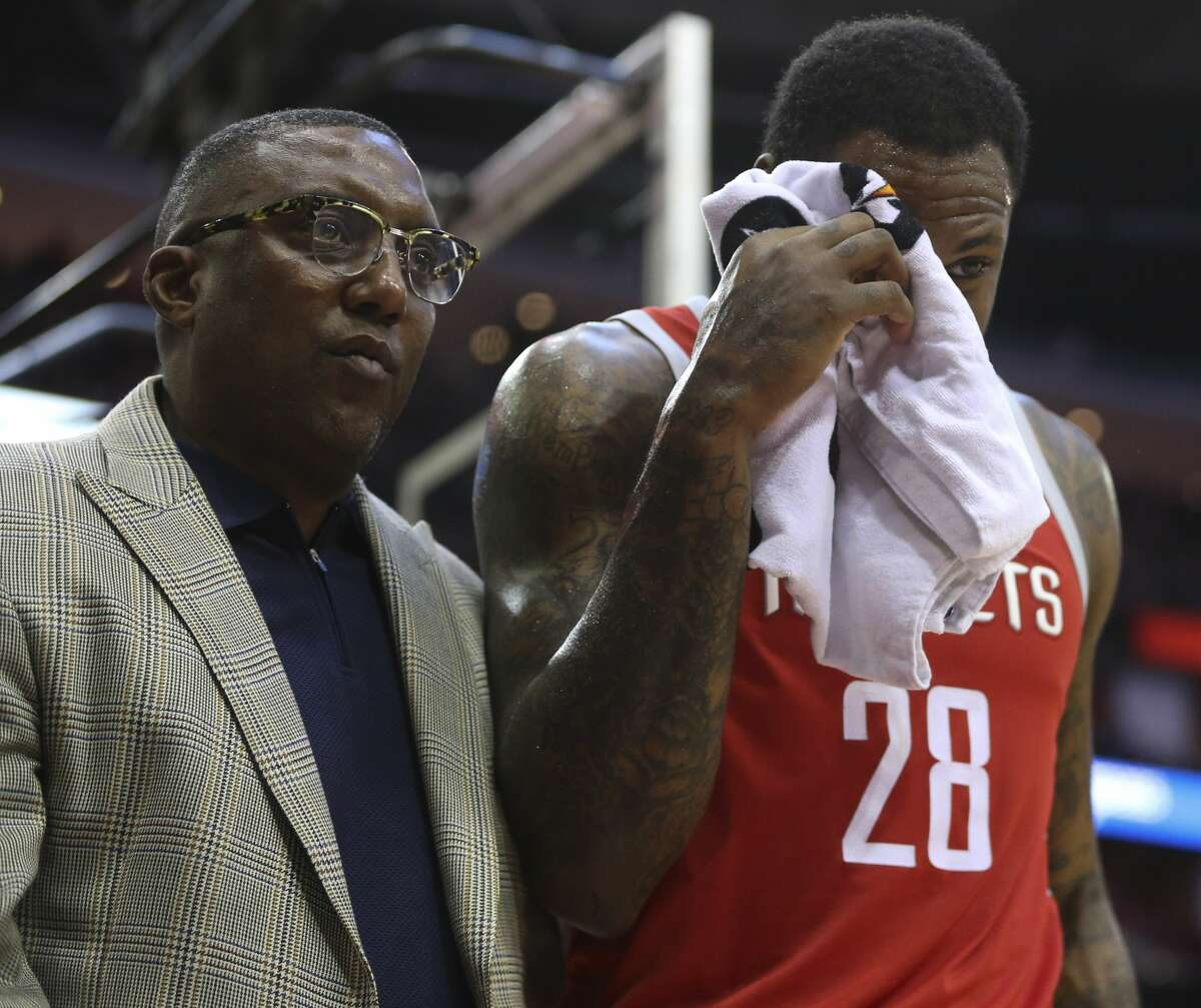 Houston Rockets forward Tarik Black (28) leaving the court covering his right eye after being fouled by Portland Trail Blazers forward Ed Davis (17) during the third quarter of the NBA game at Toyota Center on Wednesday, Jan. 10, 2018, in Houston. Black scored a dunk and Davis was called Flagrant 1 foul and Black left the court due to concussion protocol after this play. ( Yi-Chin Lee / Houston Chronicle )