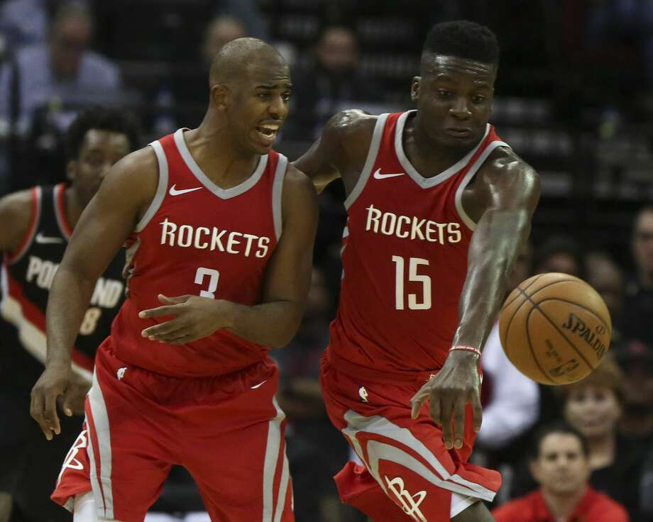 Houston Rockets players Chris Paul (3) and Clint Capela (15) try to get control of a loose ball during the fourth quarter of the NBA game against the Portland Trail Blazers at Toyota Center on Wednesday, Jan. 10, 2018, in Houston. The Houston Rockets defeated the Portland Trail Blazers 121-112. ( Yi-Chin Lee / Houston Chronicle ) Photo: Yi-Chin Lee/Houston Chronicle