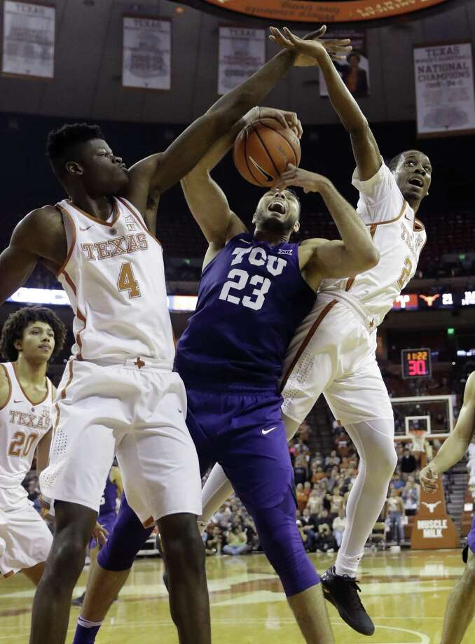 TCU forward Ahmed Hamdy-Mohamed finds his path blocked by Texas forward Mohamed Bamba (left) and guard Matt Coleman during the first half. Photo: Eric Gay / Associated Press / Copyright 2018 The Associated Press. All rights reserved.