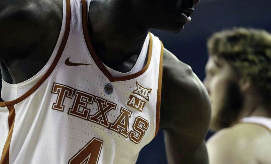 "Texas' Mohamed Bamba wears an ""AJ1"" patch to show support for teammate Andrew Jones, who is battling leukemia. Photo: Eric Gay / Associated Press / Copyright 2018 The Associated Press. All rights reserved."