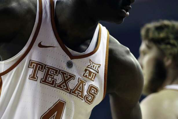 "Texas' Mohamed Bamba wears an ""AJ1"" patch to show support for teammate Andrew Jones, who is battling leukemia."
