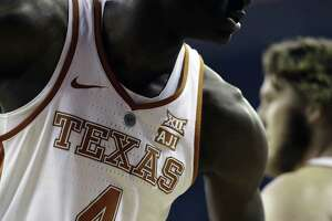 """Texas' Mohamed Bamba wears an """"AJ1"""" patch to show support for teammate Andrew Jones, who is battling leukemia."""