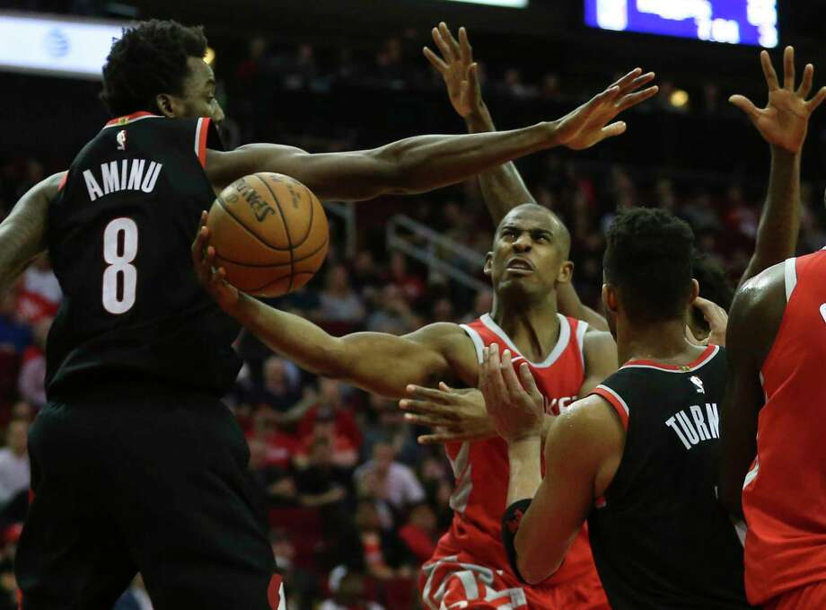 Rockets guard Chris Paul, center, overcomes the defense of the Blazers' Al-Farouq Aminu, left, and Evan Turner to get off a shot during the fourth quarter. Photo: Yi-Chin Lee, Houston Chronicle / © 2018  Houston Chronicle