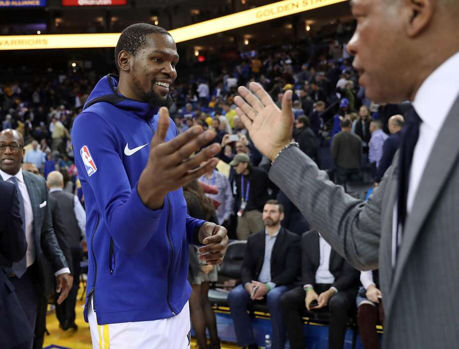 Golden State Warriors' Kevin Durant greets Los Angeles Clippers' head coach Doc Rivers after Clippers' 125-106 win during NBA game at Oracle Arena in Oakland, Calif., on Wednesday, January 10, 2018. Durant scored his 20,000th career point in 1st half of the loss. Photo: Scott Strazzante, The Chronicle
