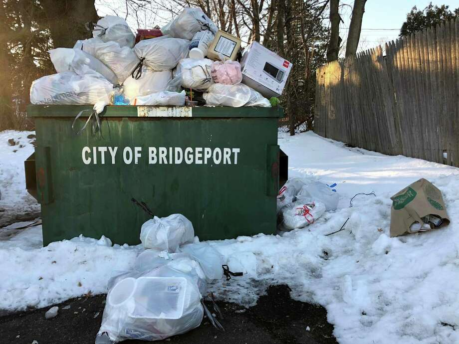 Trash piled up Wednesday, Jan. 10, 2018, in a dumpster outside the Harbor Point Condominiums in Black Rock, Bridgeport, Conn. Scores of residents complained about delayed and canceled trash pickup this week on SeeClickFix/Bridgeport 311 following a snowstorm last week that slowed sanitation workers. Photo: Contributed Photo / Jay Lederman / Contributed Photo / Connecticut Post Contributed