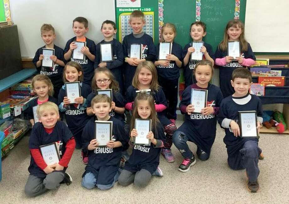 Erika Kaiser and her first grade class at Christ the King Lutheran School in Unionville recently participated in a servant event.Together, Kaiser and herclass wrote a grant to Thrivent Financial which would allow the class to purchase bibles. (Submitted Photo)