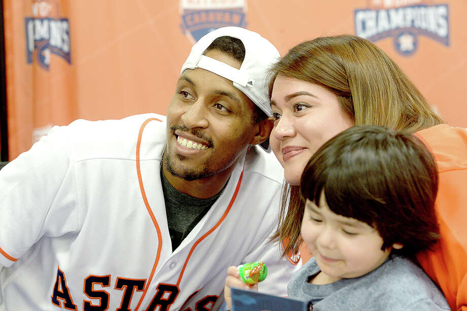 Tony Kemp poses for a photo with one of the long line of fans who gathered at Academy Sportds ad Outdoors for one of three area stops of the annual Houston Astros Caravan Wednesday. Astros players and representatives planned stops throughout the Southeast Texas region, meeting with fans, signing autographs and having a Q&A at the Caravan Jam finale in Rogers Park. The regional tour will conclude with the Astros FanFest Saturday at Minute Maid Park in Houston. Photo taken Wednesday, January 10, 2018 Kim Brent/The Enterprise Photo: Kim Brent/Beaumont Enterprise