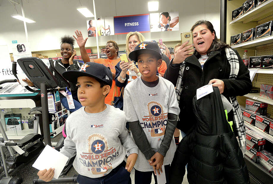From left, Jayden, Jacob, and Heather Charles join the fans in a welcoming cheer as Astros players and representatives make their entry to the Academy Sports and Outdoors store in Beaumont Wednesday. The event was among the planned stops throughout the Southeast Texas region. Players Tyler White,  Tony Kemp, and former Astro Geoff Blum met with fans, signing autographs and having a Q&A at the Caravan Jam finale later in Rogers Park. The regional tour will conclude with the Astros FanFest Saturday at Minute Maid Park in Houston. Photo taken Wednesday, January 10, 2018 Kim Brent/The Enterprise Photo: Kim Brent / BEN
