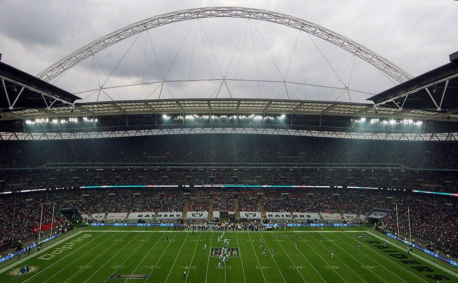 In this handout image provided by NFL UK,  a general view at the start of the NFL football game between Miami Dolphins and Oakland Raiders at Wembley Stadium in London, Sunday, Sept. 28, 2014.. Photo: Nicky Hayes, Associated Press