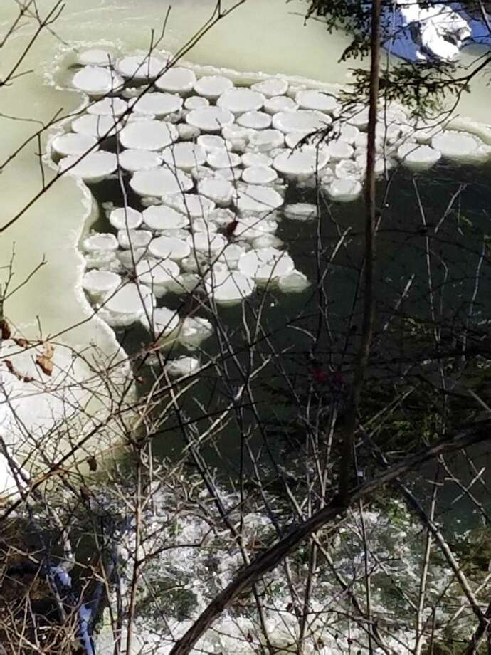 Cliff Bates was hiking the Appalachian Trail Jan. 1 with his dog in 9-degree weather when he saw some slowly-rotating discs of ice on the Housatonic River that resembled UFO saucers. Photo: By Jessica Lerner / Photo Courtesy Of Cliff Bates