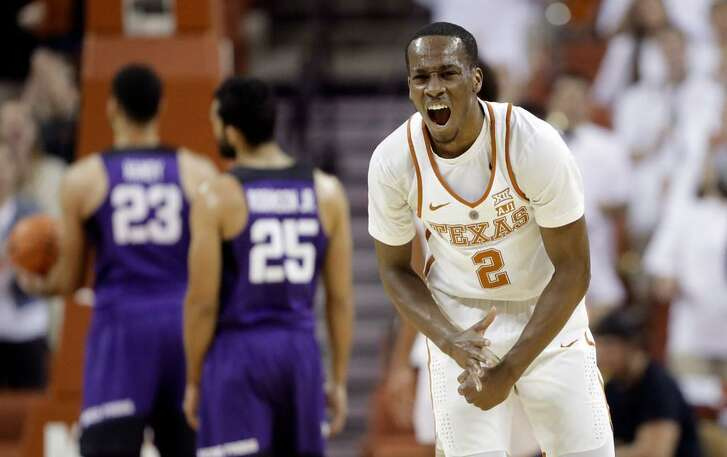 Texas guard Matt Coleman (2) celebrates a score against TCU during the Longhorns' double-overtime victory Wednesday night in Austin, Texas.