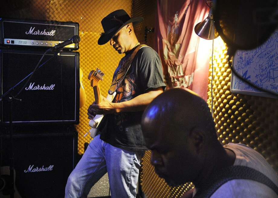 State Senator George Logan rehearses with his Jimi Hendrix tribute band, the Electric Lady Band, which includes his brother Hector, right, on bass, in his basement recording studio in Ansonia, Conn. on Monday, August 14, 2017. The band will be performing from 6-7 p.m. at Nolan Field in Ansonia on Saturday as part of the Rock the Valley music festival. Photo: Brian A. Pounds / Hearst Connecticut Media / Connecticut Post