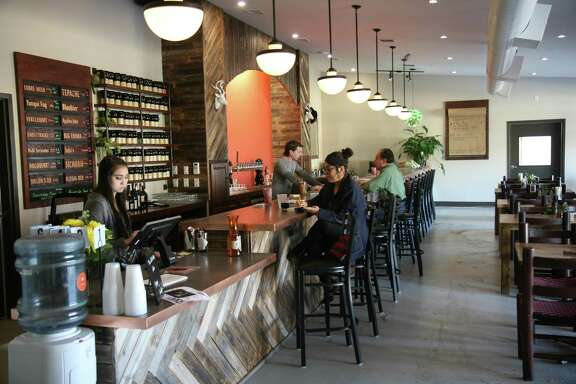 The Künstler Brewing tap room, which is still in the process of being outfitted with decor, features a wide selection of beers and a small food menu. There is also a separate room with large TVs for showing sporting events.