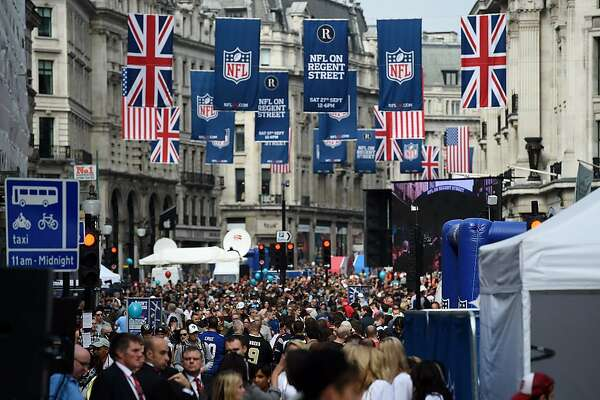 Crowds begin to gather during NFL on Regent Street, a fan rally event on Regent Street, London, England, Saturday, Sept. 27, 2014.  The Oakland Raiders will play the Miami Dolphins in an NFL football game at London's Wembley Stadium on Sunday Sept. 28. (AP Photo/Tim Ireland)