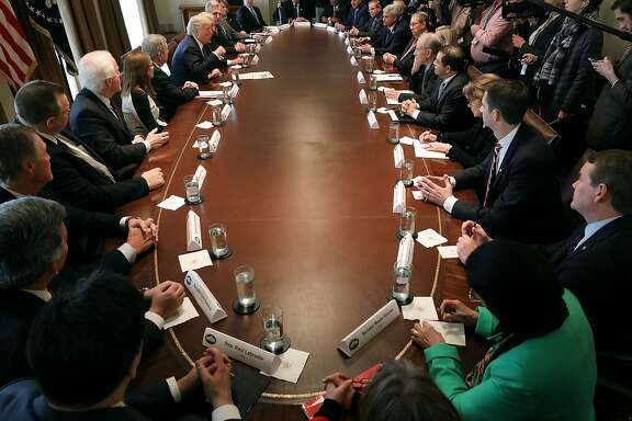 WASHINGTON, DC - JANUARY 09:  U.S. President Donald Trump presides over a meeting about immigration with Republican and Democrat members of Congress in the Cabinet Room at the White House January 9, 2018 in Washington, DC. In addition to seeking bipartisan solutions to immigration reform, Trump advocated for the reintroduction of earmarks as a way to break the legislative stalemate in Congress.  (Photo by Chip Somodevilla/Getty Images) *** BESTPIX ***