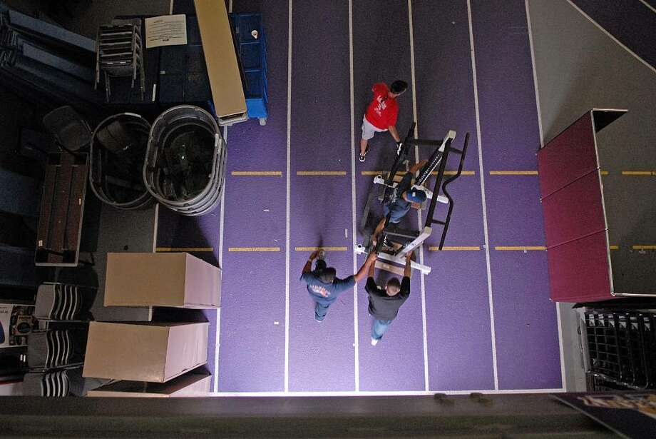 University at Albany workers unload weightlifting equipment into SEFCU Arena as crews around campus prepared for the New York Giants training camp on Wednesday, July 22.   (Paul Buckowski / Times Union) Photo: PAUL BUCKOWSKI / 00004783A