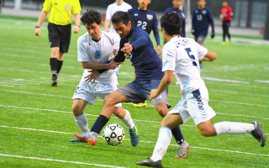 Cy Ridge's Moises Benitez makes a play. Two out of the last three years, Cy Ridge has gone deeper in the playoffs than any team in district. They made the regional semifinals last year and even won district back in 2009. Photo: Tony Gaines/ HCN, Photographer