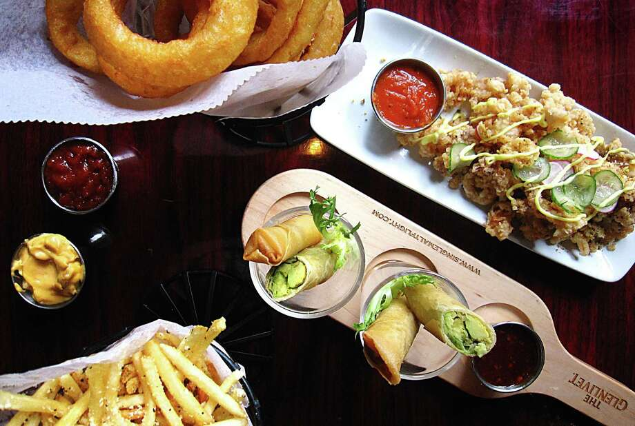 Chicken-fried onion rings, fried calamari, Cigar Rolls and truffle fries from Tribeca 212. Photo: Mike Sutter /San Antonio Express-News