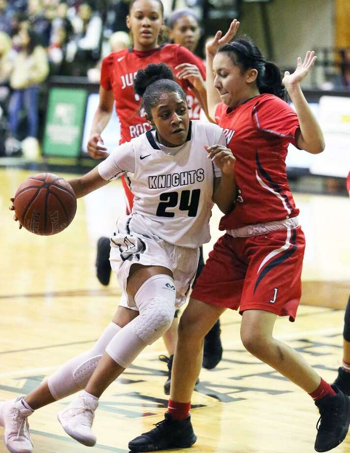 Steele guard Desiree Caldwell wedges into the lane against Victoria Gonzales as Steele hosts Judson in girls basketball on Jan. 2, 2018 Photo: Tom Reel /San Antonio Express-News