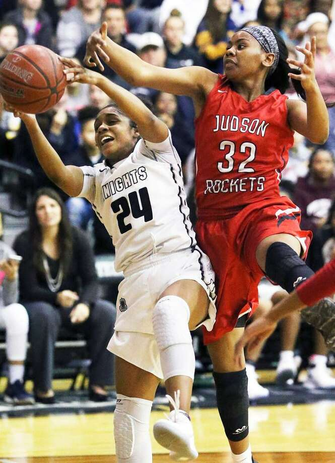 Knight guard Desiree Caldwell yanks down a defensive rebound away from Desiree Lewis as Steele hosts Judson in girls basketball on Jan. 2, 2018. Both were named to the TABC 6A all-state team. Photo: Tom Reel /San Antonio Express-News