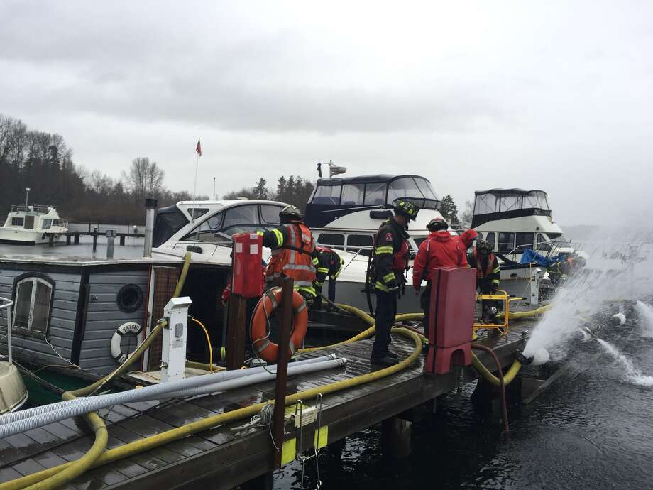 Seattle Fire crews have responded to a house boat sinking on Thursday near Seward Park. Photo: Seattle Fire