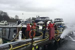 Seattle Fire crews have responded to a house boat sinking on Thursday near Seward Park.