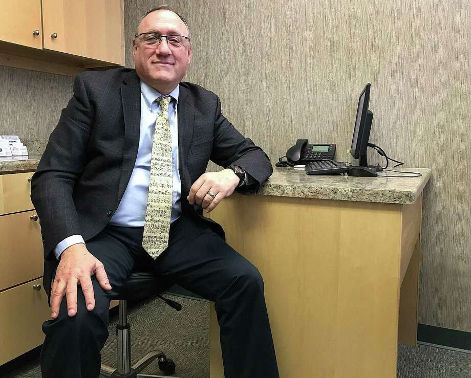F. Scott Gray, managing partner with Connecticut Family Orthopedics in Danbury, Conn., sits in a patient's room on Wednesday, Jan. 10, 2017, as he discusses the addition of OccPrompt to the practice. Photo: Chris Bosak / Hearst Connecticut Media / The News-Times