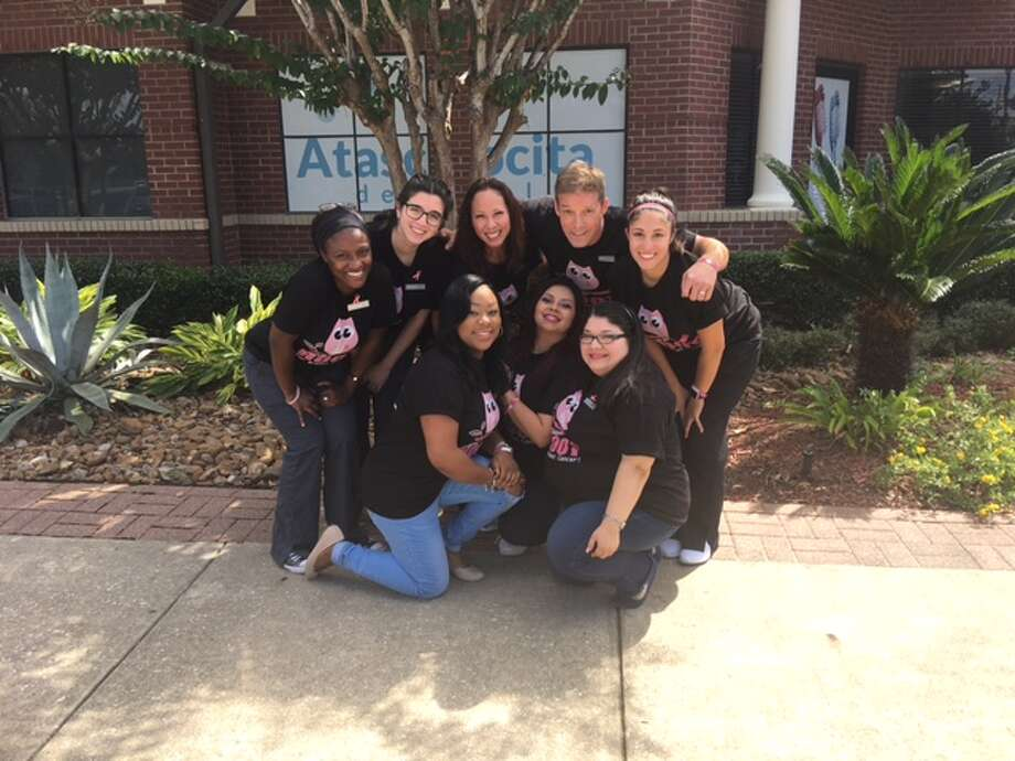 Atascocita Dental staff pose for a photo. Their office will host their fourth annual Dentistry from the Heart event on Friday, March 2, during which people in need may receive free dental care. Photo: Courtesy Of Atascocita Dental