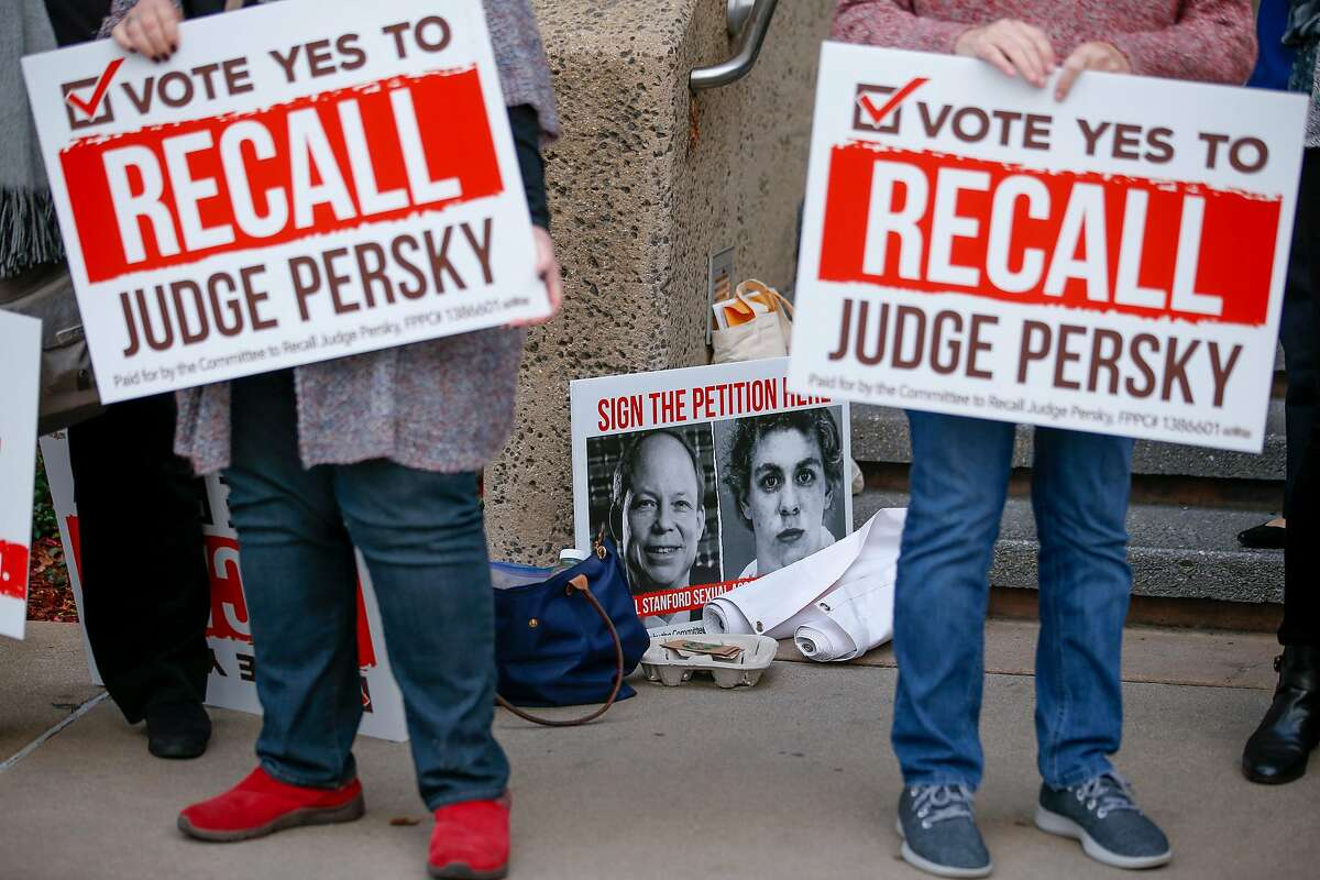 Volunteers for the Recall Persky Campaign, stand with signs outside the Santa Clara County Registrar of Voters on Thursday, January 11, 2018, in San Jose, California. The group turned in nearly 100,000 signatures at the Santa Clara County Registrar of Voters to call for the recall of Judge Aaron Persky. Judge? Persky sentenced Brock Turner, a Stanford swim team member, to six months in jail after being found guilty of three felony sex crimes for sexually assaulting an unconscious woman behind a dumpster at a frat party.