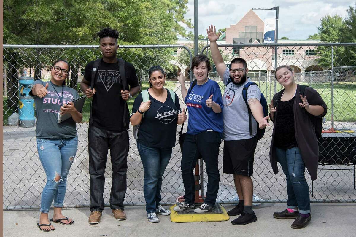 Students of Lone Star College-Kingwood pose in front of the campus, which undergoing restoration after sustaining flood damage during Hurricane Harvey.