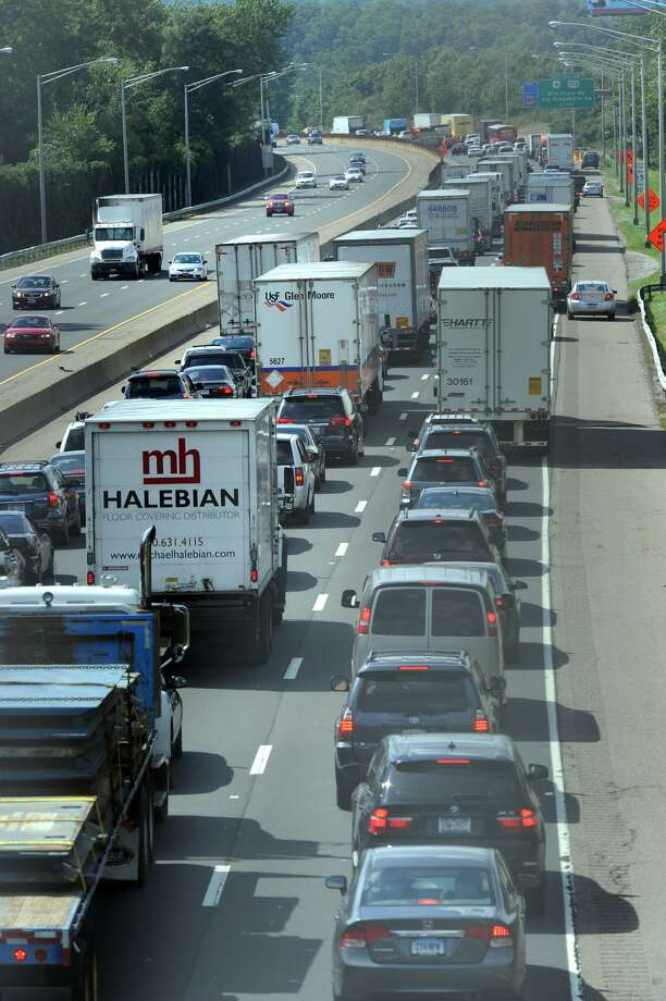 This traffic was backed up on I-84 West in Danbury in the summer because an accident involving two tractor trailers and a car, but the congestion is a common scene during rush hours every day. Photo: Carol Kaliff / Carol Kaliff / The News-Times