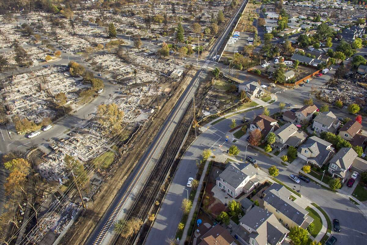 The Coffey Lane neighborhood is devastated by the Tubbs Fire as the neighborhood off of Gold Leaf Lane is seen with only some damage from the Tubbs Fire, Friday, Oct. 20, 2017, in Santa Rosa, Calif.