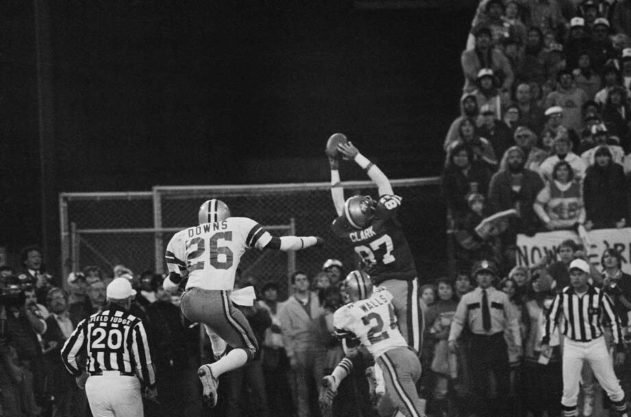 (Original Caption) San Francisco 49ers Dwight Clark (87, WR), goes up in the air in the end zone for the game-tying touchdown pass from Qb Joe Montana to set up the PAT which beat the Dallas Cowboys to give the 49ers their first NFC Championship and Super Bowl berth. At right is Cowboys Michael Downs (26, S) and at right Everson Walls (24, CB). Photo: Bettmann, Bettmann Archive
