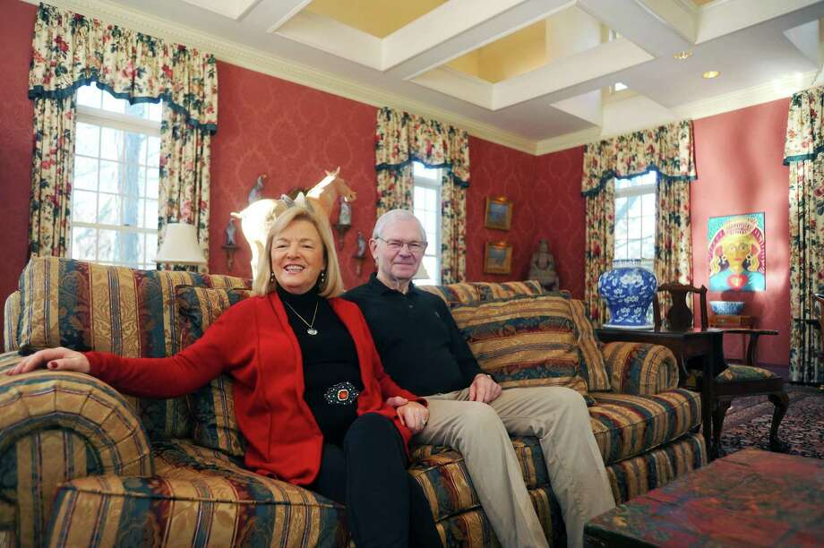 George and Carole Thomassy pose for a photo inside the great room of their on-the-market house on Westover Road in Stamford, Conn. on Wednesday, Jan. 10, 2018. Photo: Michael Cummo / Hearst Connecticut Media / Stamford Advocate