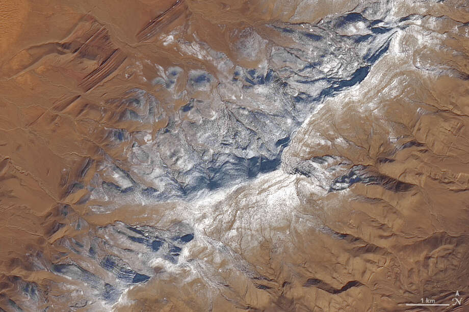"""""""For the second time in three years, snow has fallen near the northern Algerian town of Aïn Séfra. On January 8, 2018, the Operational Land Imager (OLI) on Landsat 8 captured the data for these natural-color images of the snow in the Sahara Desert,""""NASAreports. Photo: NASA Earth Observatory Image / Joshua Stevens"""