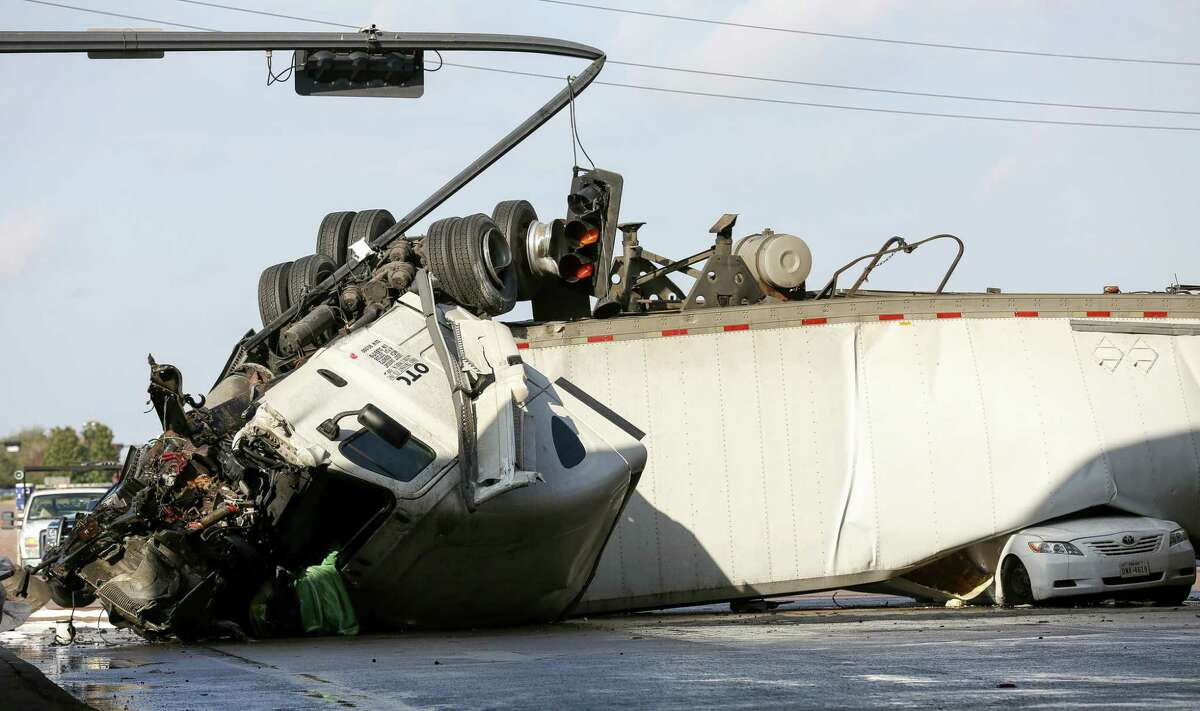 An 18-wheeler was overturned off the southbound lanes of U.S. 69 Freeway on University Boulevard Thursday, Jan. 11, 2018, in Sugar Land, Texas.