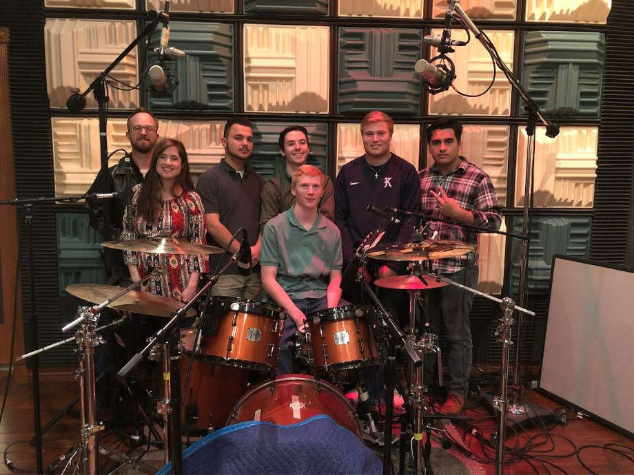 Members from local bands, Jay and the Nightingale, andLives of Nick, practice their collaborative song, 'Build it Back,' for the Jan. 20 benefit concert for Kingwood High School music departments. Photo: Courtesy Of Shari Krienke