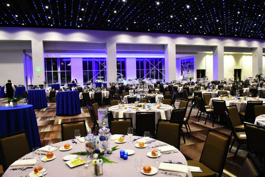 The main room at the 10-month-old Albany Capital Center event and convention facility in Albany awaits a 500-person holiday dinner and party on Dec. 16, 2017. Over two weeks during this past holiday season, the venue's first, it hosted more than 5,000 people for cocktails, dinners, parties and other events. Catering is handled by Clifton Park-based Mazzone Hospitality. (Steve Barnes/Times Union.)